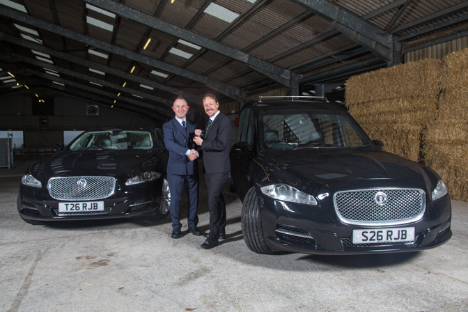 David, receiving the keys to the latest additions to our fleet - a Jaguar hearse and limousine.